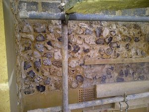 Partially completed wall with traditional flint work